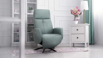 Blue classic armchair with table lamp and flower vase